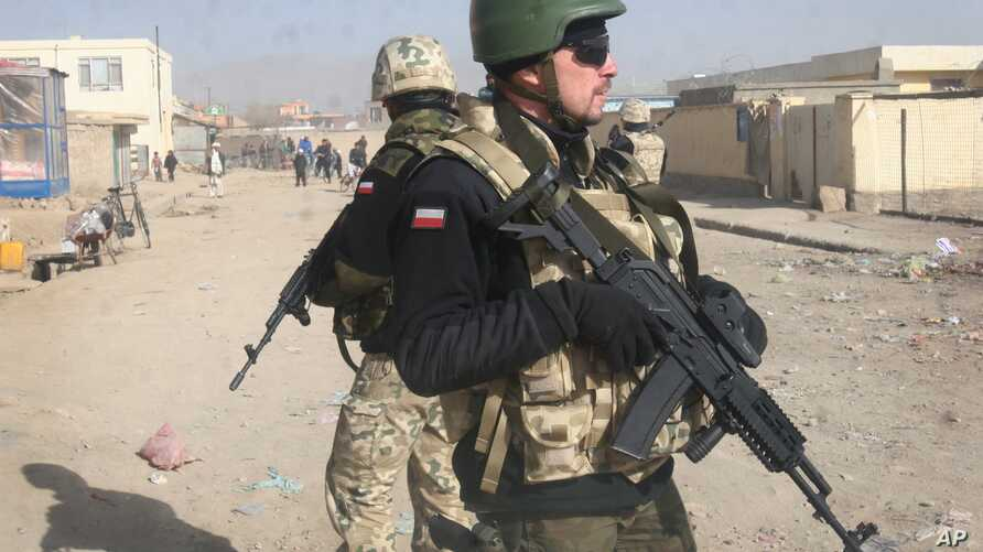 FILE - Polish NATO soldiers are seen patrolling in Ghazni, west of Kabul, Afghanistan, Dec. 21, 2011. Polish and Afghan special forces, backed by U.S. air power, freed 11 hostages held by the Taliban in Afghanistan's Helmand province, Poland's defens