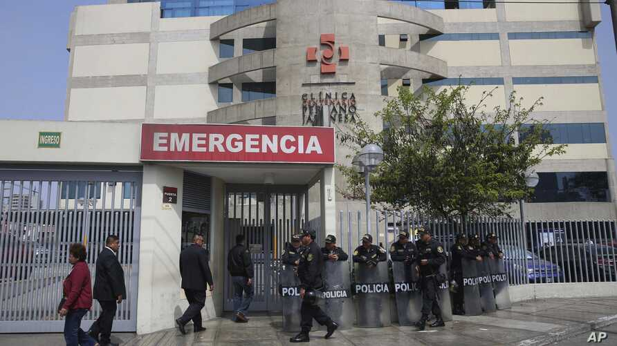 Riot police stand guard in front of the Centenario clinic where Peru's former President Alberto Fujimori is hospitalized, in Lima, Peru, Oct. 4, 2018.