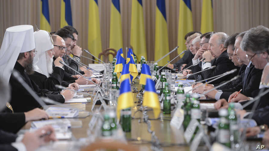 Ukraine's political, government, opposition and religious leaders at a round-table meeting in Kiev, Ukraine, Friday, Dec. 13, 2013.