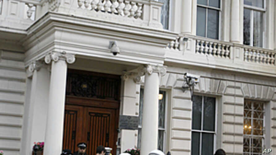 British police stand guard outside the Iranian Embassy in London. Britain's foreign secretary on Wednesday ordered all Iranian diplomats out of the U.K within 48 hours following attacks on the British embassy and a residential compound in Tehran, Nov