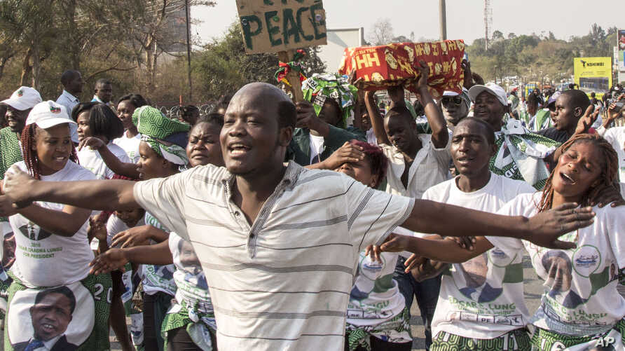 Supporters of the ruling Patriotic Front celebrate the results of the presidential election in Lusaka, Zambia, Aug. 15, 2016.