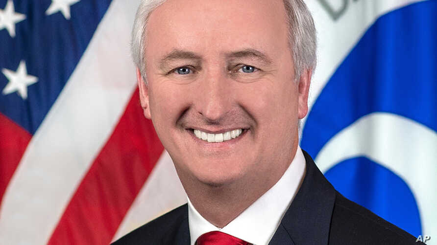 FILE - In this image provided by the Department of Transportation, deputy transportation secretary Jeffrey Rosen is shown in his official portrait in Washington.