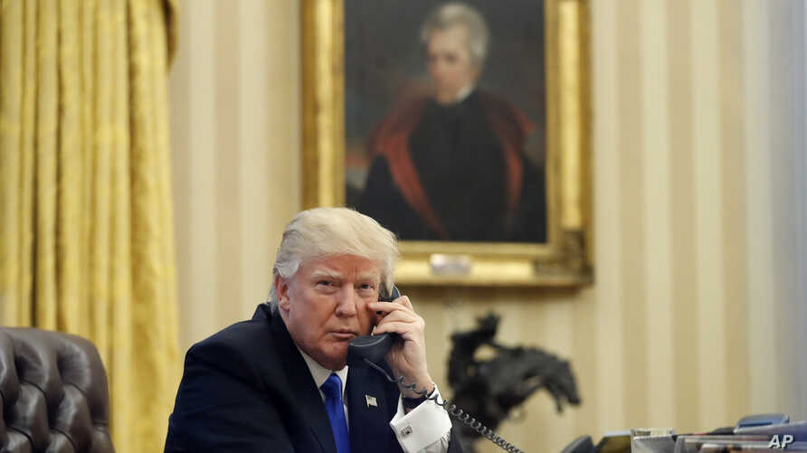 FILE - In this Saturday, Jan. 28, 2017 file photo, President Donald Trump speaks on the telephone with Australian Prime Minister Malcolm Turnbull in the Oval Office of the White House in Washington.