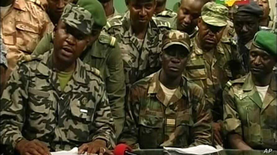 Renegade Malian soldiers appear on television at the ORTM television studio in Bamako, March 22, 2012 still image taken from video.