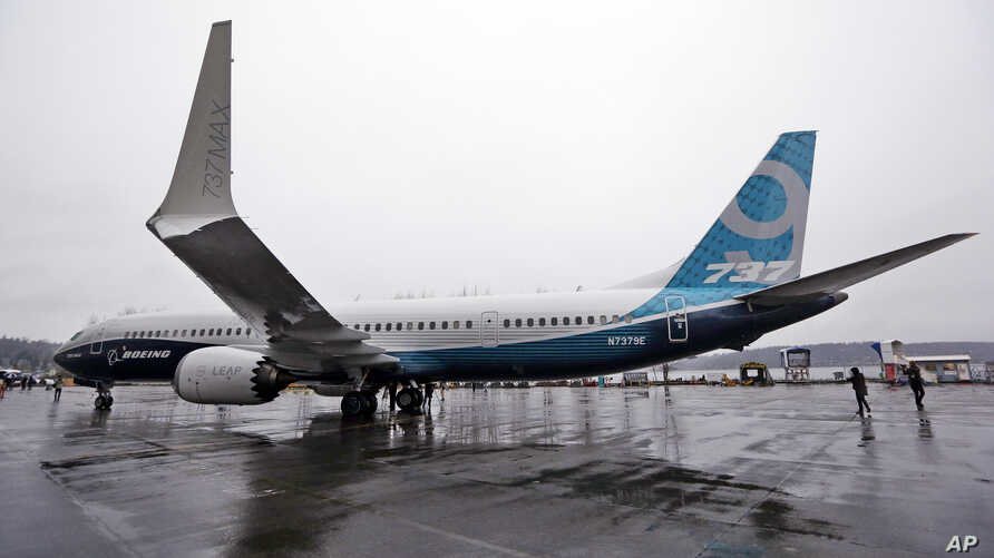 LE -- In this March 7, 2017 file photo, the first of the large Boeing 737 MAX 9 models, Boeing's newest commercial airplane, sits outside its production plant, in Renton, Wash. Boeing Co. announced Tuesday, April 4, 2017 that it has signed a new, $3