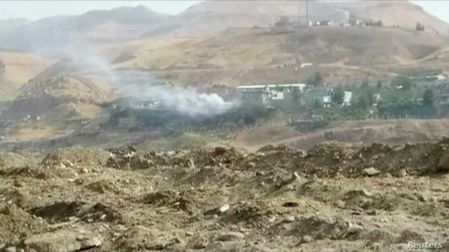Smoke rises from buildings at the site of a car bomb explosion at a police headquarters in Cizre, located in Turkey's Sirnak province bordering both Syria and Iraq, in this still image from video, Aug. 26, 2016.