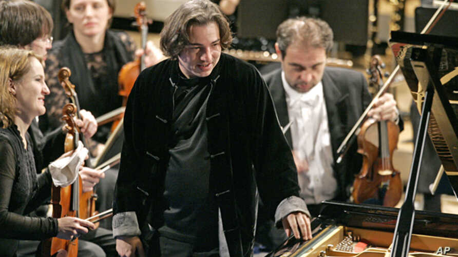Turkish pianist Fazil Say, center, plays during a performance at the World Economic Forum in Davos, Switzerland, Jan. 31, 2009.