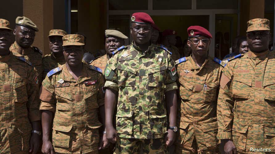 Lieutenant Colonel Yacouba Isaac Zida (C) poses for a picture after a news conference in which he was named president at the military headquarters in Ouagadougou, Nov. 1, 2014.