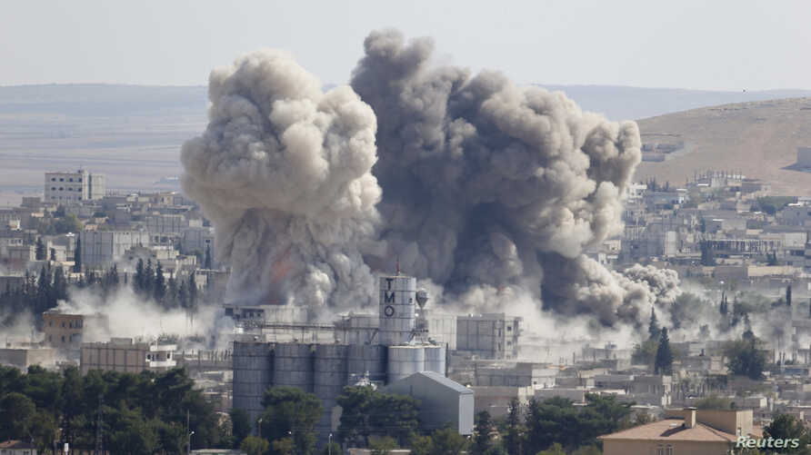 Smoke rises after an U.S.-led air strike in the Syrian town of Kobani, Oct. 8, 2014.