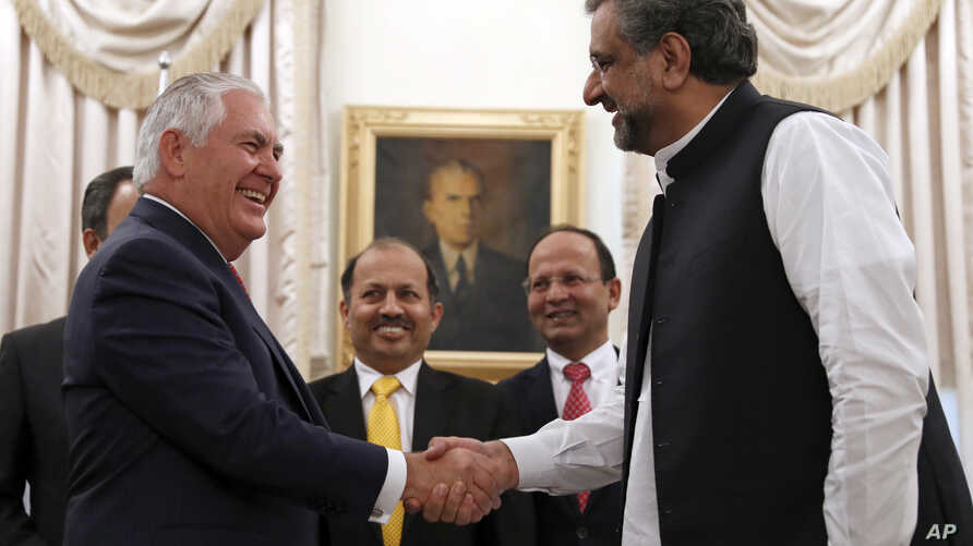 U.S. Secretary of State Rex Tillerson shakes hands with Pakistani Prime Minister Shahid Khan Abbasi before their meeting at the prime minister's residence, in Islamabad, Pakistan, Oct. 24, 2017.