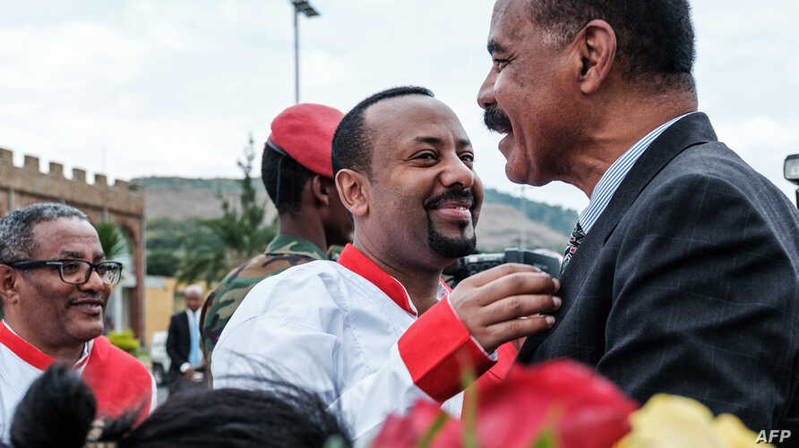 Ethiopia's Prime Minister Abiy Ahmed (C) welcomes Eritrea's President Isaias Afwerki upon his arrival at the airport in Gondar, for a visit in Ethiopia, on Nov. 9, 2018.