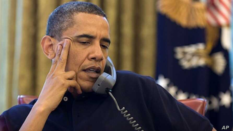 President Barack Obama talks on the phone with Prime Minister David Cameron of the United Kingdom in the Oval Office, Saturday, June 12, 2010.