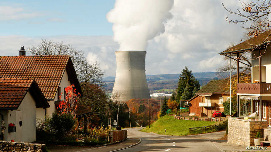 Steam emerges from a cooling tower of the nuclear power plant Leibstadt near Leibstadt, Switzerland, Nov. 18, 2014.