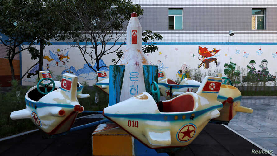 A swing in the form of a missile is seen at a kindergarten and day care for employees' children at a silk factory during a government organised visit for foreign reporters ahead of the 70th anniversary of North Korea's foundation in Pyongyang, North