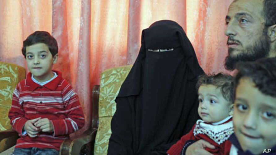 Syrian refugees who fled the violence in Syria speak to Reuters TV at their temporary home in Amman, Jordan, November 14, 2011.