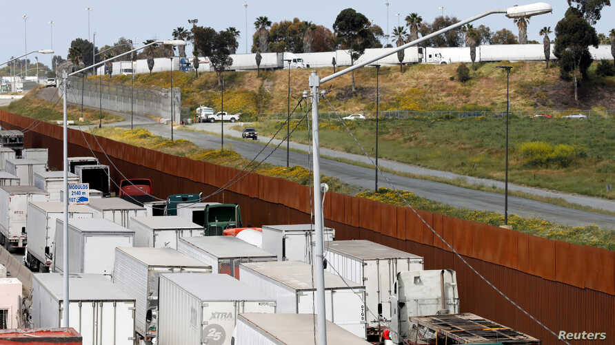 Trucks wait in a long queue at border customs control to cross into the U.S, at the Otay border crossing in Tijuana, Mexico April 3, 2019. The wait has been caused by the redeployment of border officers to deal with a surge in migrants.