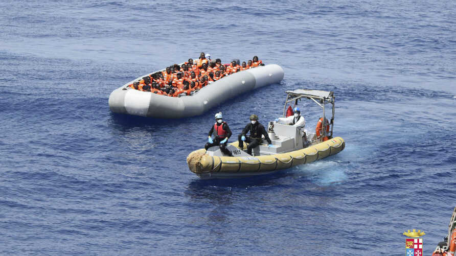 This undated image made available on May 30, 2016 by the Italian Navy Marina Militare shows migrants being rescued at sea.