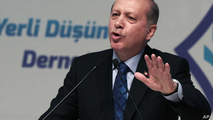 """Turkey's President Recep Tayyip Erdogan addresses his supporters in Ankara, Turkey, Thursday, May 12, 2016. Erdogan says his country is gearing up to """"clear"""" the Syrian side of its frontier in response to cross-border fire from the Islamic State grou..."""