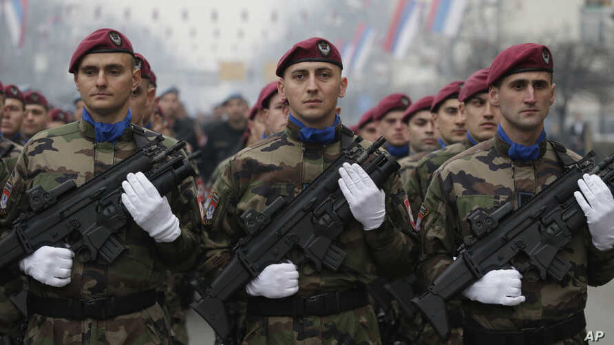Members of the police forces of Republic of Srpska stand guard moments before a parade marking the 26th anniversary of the Republika Srpska in the Bosnian town of Banja Luka, Jan. 9, 2018.