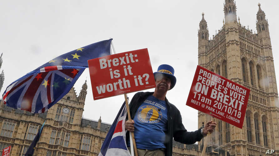 A demonstrator protests in front of parliament in London, Oct. 17, 2018.