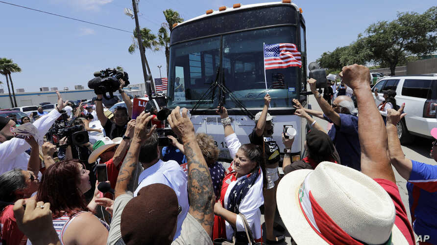 Demonstrators block a bus with immigrant children aboard during a protest outside the U.S. Border Patrol Central Processing Center, June 23, 2018, in McAllen, Texas. Extra law enforcement officials were called in to help control the scene and allow t