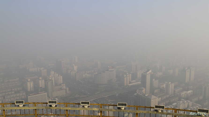 A view from a viewing deck on the China Central Radio and Television Tower shows the city of Beijing in heavy smog, China, November 29, 2015. Heavy smog continues in Beijing on Sunday after a yellow alert of air pollution was issued on Friday, local