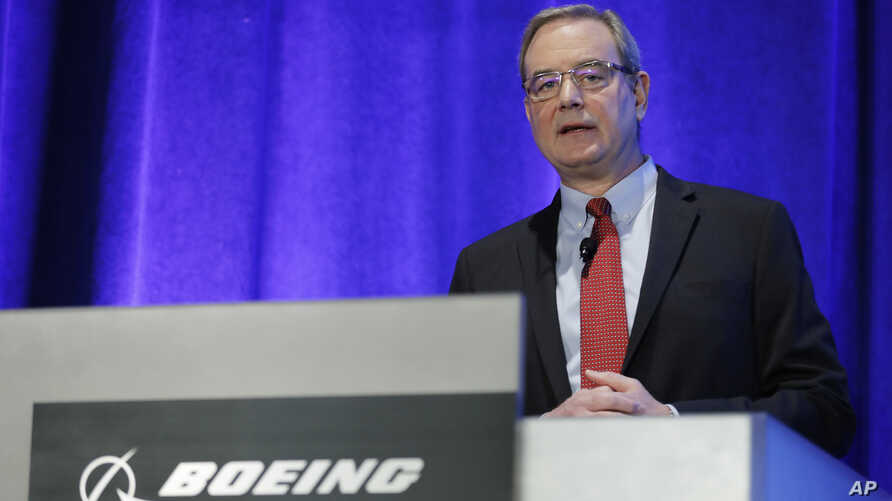 Mike Sinnett, Boeing's Vice President of Product Strategy, talks to reporters,  March 27, 2019, about software and training updates for their 737 MAX 8 airplane in Renton, Washington.