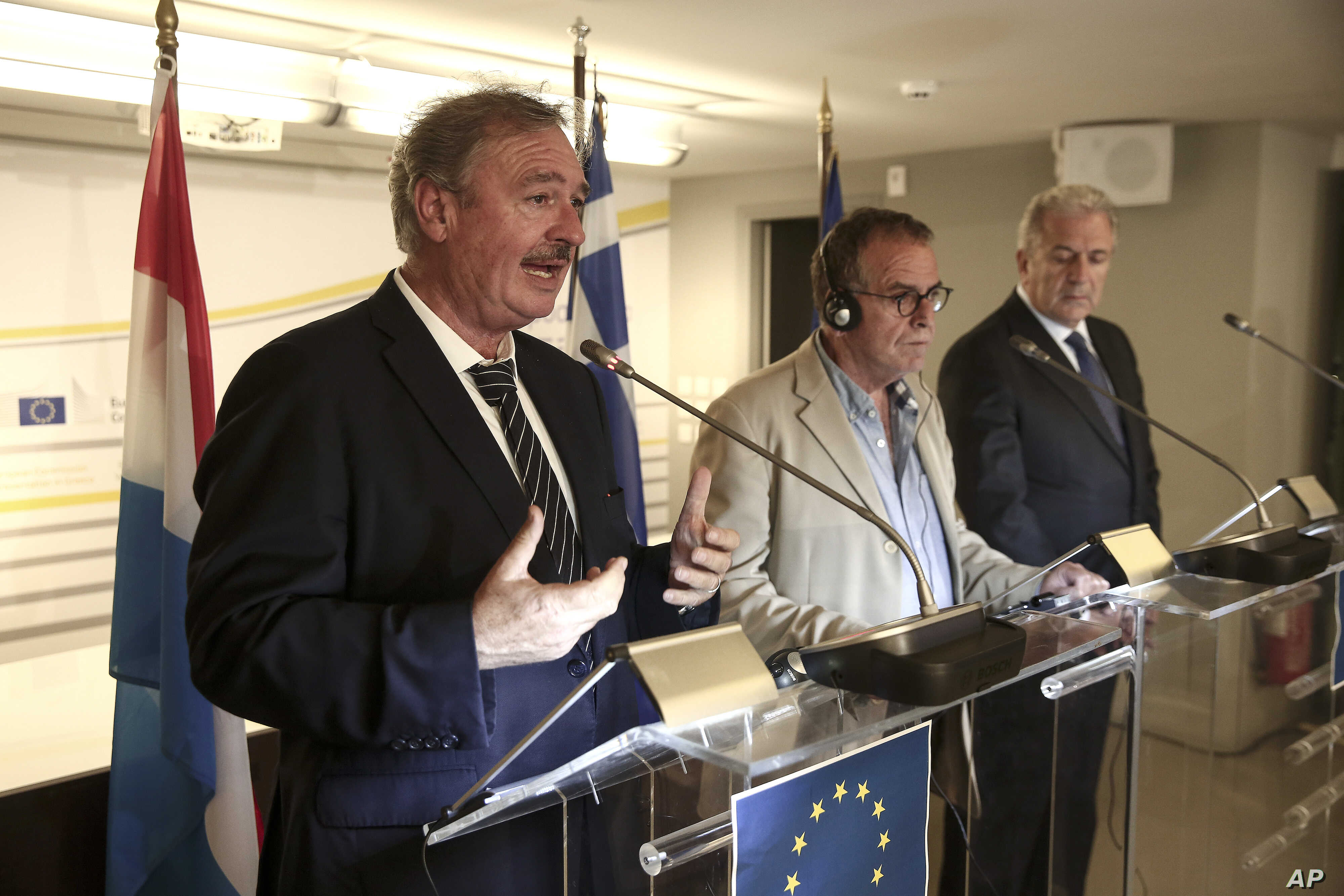 Luxembourg's Minister of Foreign and European Affairs Jean Asselborn, left, Greece's alternate Immigration Policy Minister Ioannis Mouzalas, and European Commissioner for Migration and Home Affairs Dimitris Avramopoulos during a news conference in At