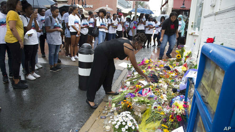 Howard University students pause at the site where Heather Heyer was killed by a car in Charlottesville, Virginia, Aug. 18, 2017. About fifty Howard University students visited the site where Heyer died while protesting a white nationalist rally on A