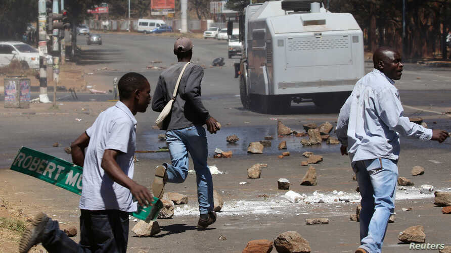 Opposition party supporters clash with police in Harare, Zimbabwe, Aug. 26, 2016.