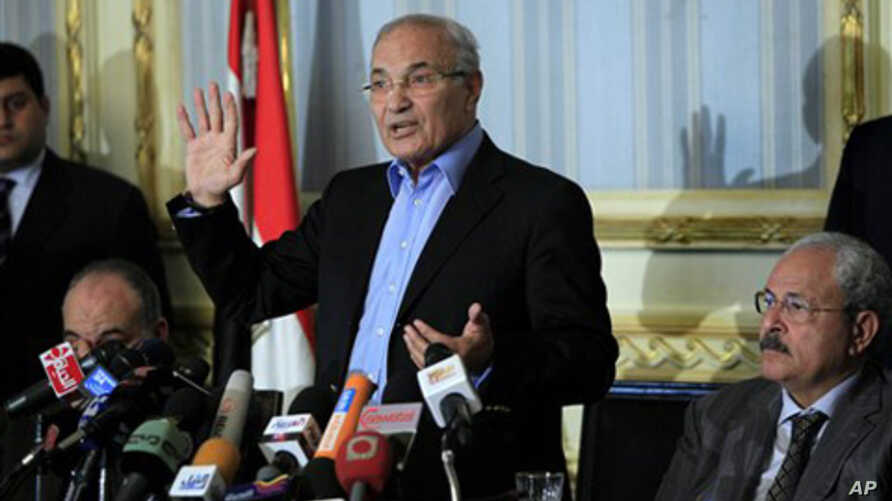 Egyptian Prime Minister Ahmed Shafiq talks during a press conference in Cairo, February 13, 2011