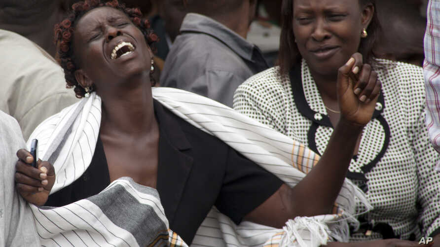 A woman at the Chiromo funeral home in Nairobi cries after she viewed the body of a relative killed in Thursday's attack on a Kenyan university, April 4, 2015.