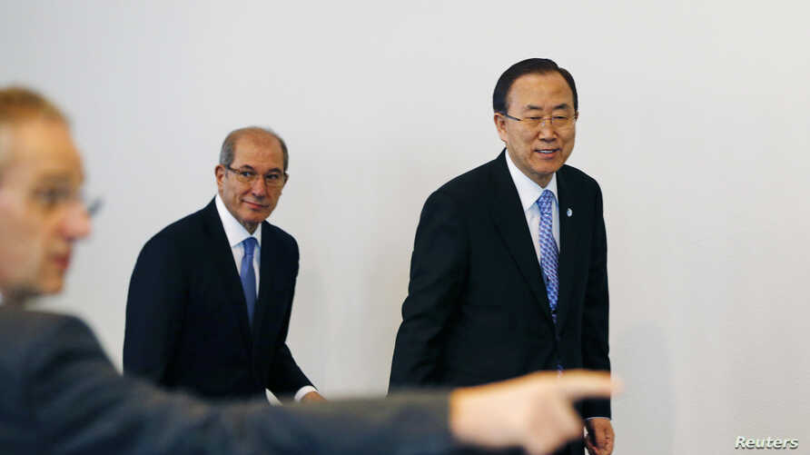 U.N. Secretary-General Ban Ki-moon (R) and Organisation for the Prohibition of Chemical Weapons (OPCW) Director-General Ahmet Uzumcu (C) arrive at a news conference at the OPCW in the Hague Apr. 8, 2013.