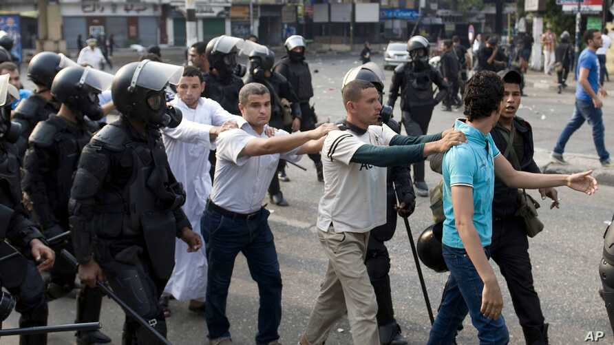 FILE - In this Sunday, Oct. 6, 2013 file photo, supporters of Egypt's ousted President Mohammed Morsi are detained during clashes with riot police in Cairo, Egypt. Rights groups say sweeping crackdowns on Islamist opponents and liberal activists mark