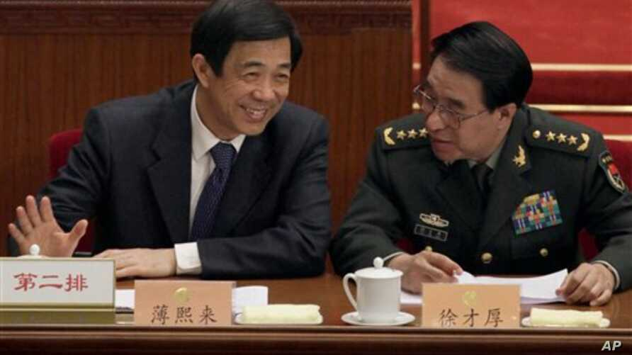 Bo Xilai, left, Chongqing's disgraced Communist Party leader, chats with Xu Caihou, vice chairman of China's Central Military Commission, at the People's Political Consultative Conference in the Great Hall of the People in Beijing, China, March 3, 20