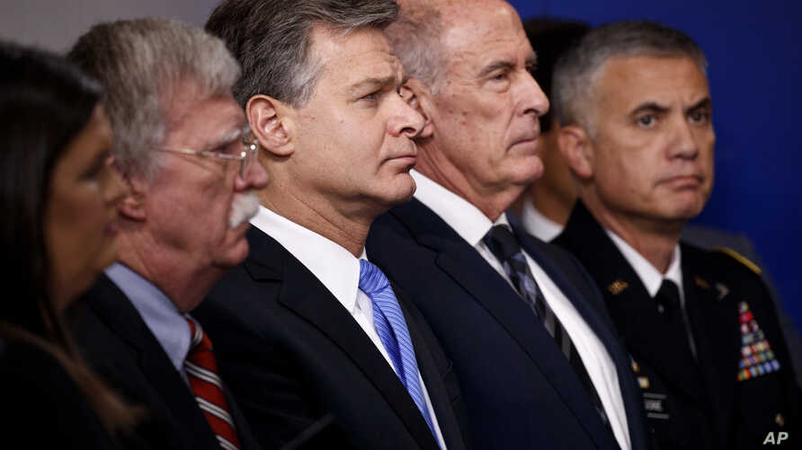 (L-R) White House press secretary Sarah Huckabee Sanders, national security adviser John Bolton, FBI Director Christopher Wray, Director of National Intelligence Dan Coats, and National Security Agency Director Gen. Paul Nakasone listen during the da