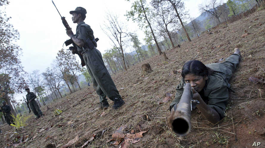 FILE - Maoist rebels or Naxalites, officially the Communist Party of India (Maoist), that takes its name from the Naxalbari, a village outside Kolkata where the revolt began in 1967.