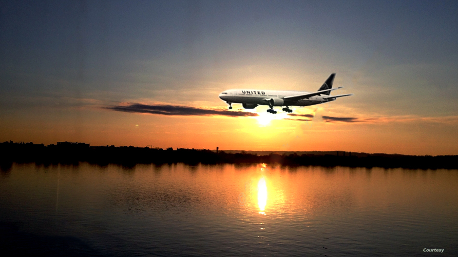 A United plane is getting ready to land at Reagan National Airport near Washington, D.C. Millions of travelers are criss-crossing the United States this week, clogging airport terminals in a rush to reach their Thanksgiving Day destinations. (Photo b