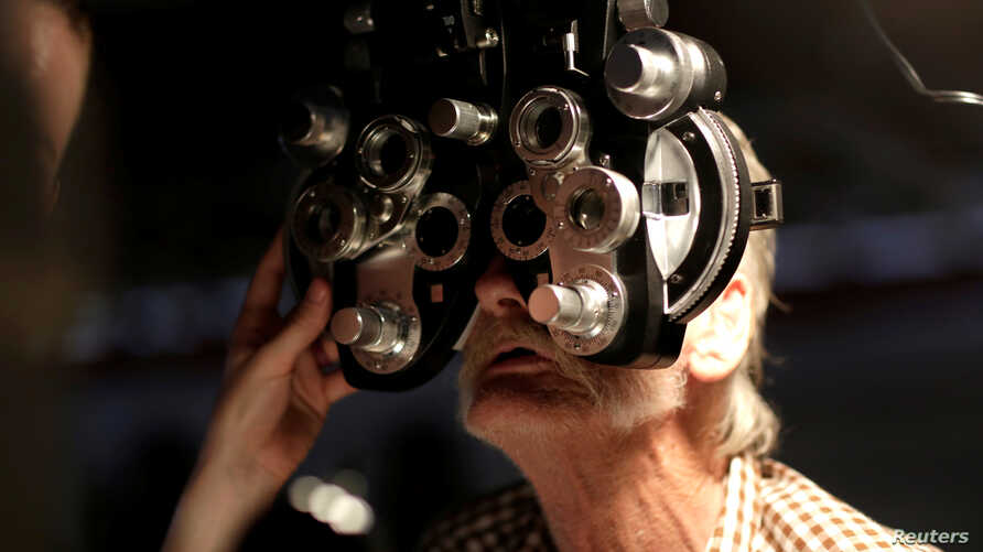 A man receives an eye exam at the Remote Area Medical Clinic in Wise, Virginia, July 22, 2017.
