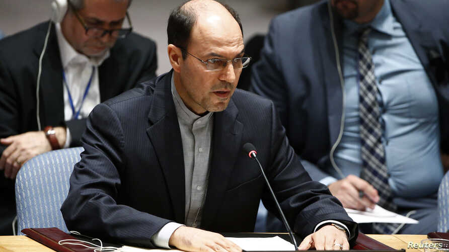"""FILE - Hossein Dehghani, Iran's deputy U.N. representative who is shown addressing the Security Council in July 2014, says a resolution condemning Iran for rights violations is a """"selective and politicized distortion of facts."""""""