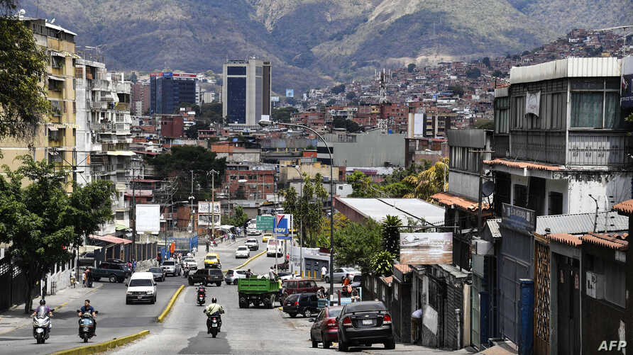 A view of Petare neighborhood in Caracas where people try to return to normal life after severe power cuts affected the country on March 13, 2019.