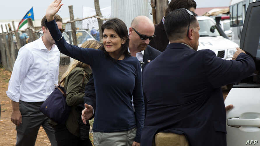 US Ambassador to the UN, Nikki Haley waves towards Internally Displaced People (IDP) while she is being evacuated by her protection force, following a demonstration in Juba, South Sudan, on October 25, 2017.