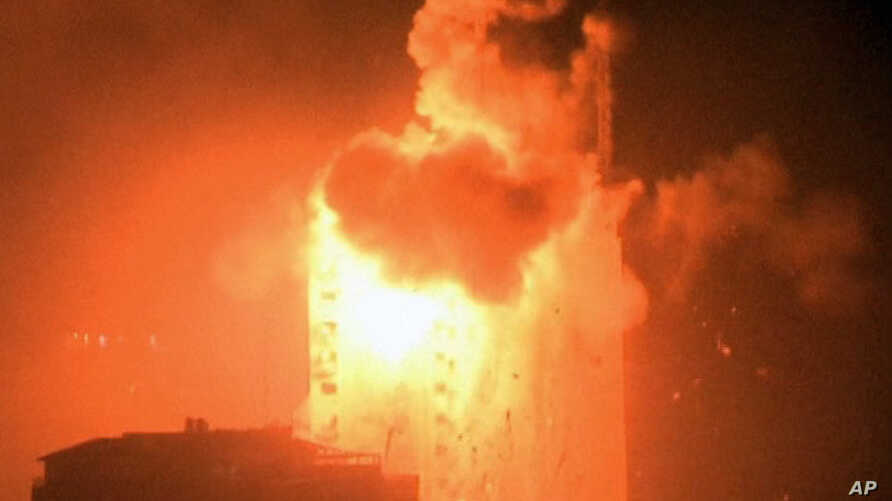 In this image taken from video an explosion hits the media complex that houses the offices of Hamas-run Al Aqsa television and radio in central Gaza City, July 29, 2014.