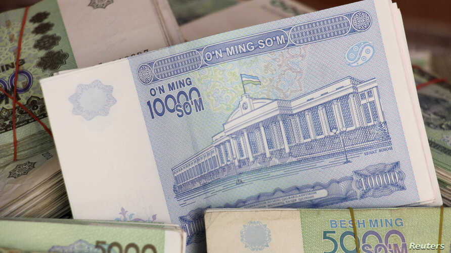 FILE PHOTO: Uzbekistani Som banknotes are seen in this picture illustration taken May 4, 2017.