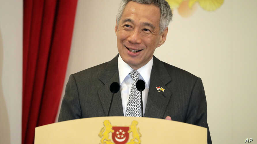 FILE - Singapore's Prime Minister Lee Hsien Loong delivers a speech during the launch of Commemorative Notes of the 50th Anniversary of the Currency Interchangeability Agreement between Singapore and Brunei at the Istana, July 5, 2017, in Singapore.