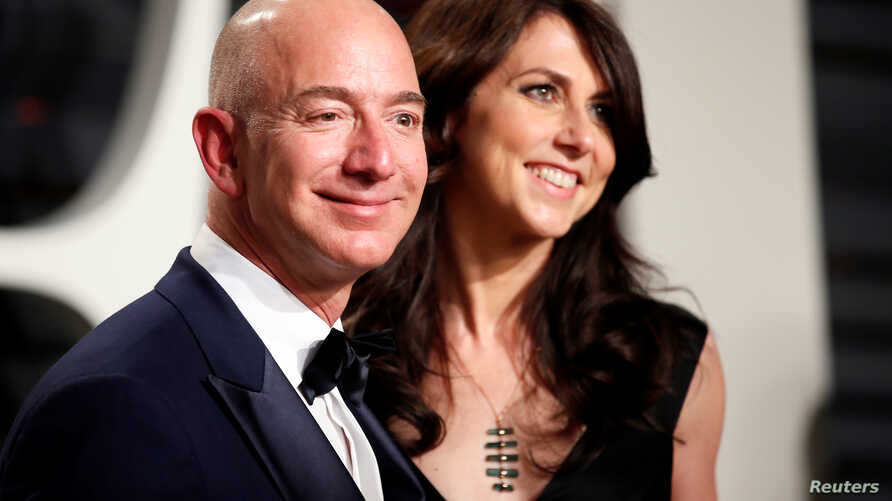 FILE - Amazon's Jeff Bezos and MacKenzie Bezos are seen before their recent divorce at the 89th Academy Awards Oscars Vanity Fair Party, Beverly Hills, California, U.S., Feb 2, 2017.