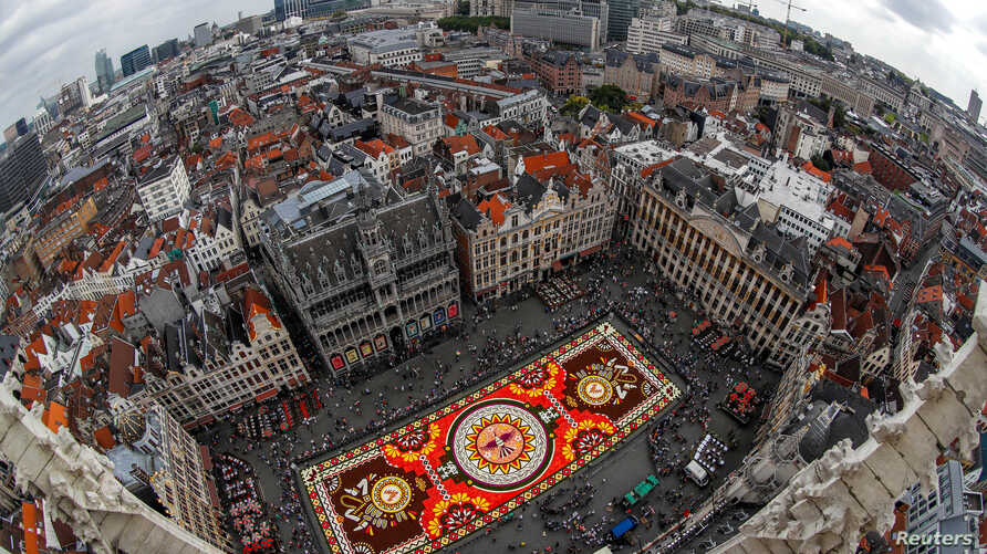 """A 1,800 square meters flower carpet on the theme """"Guanajuato, cultural pride of Mexico"""" and made with over 500,000 dahlias and begonias is seen at Brussels' Grand Place, Belgium August 16, 2018."""