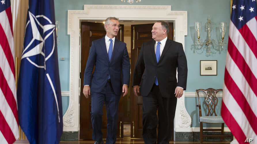 Secretary of State Mike Pompeo, right, meets with NATO Secretary General Jens Stoltenberg at the State Department in Washington, Sept. 13, 2018.
