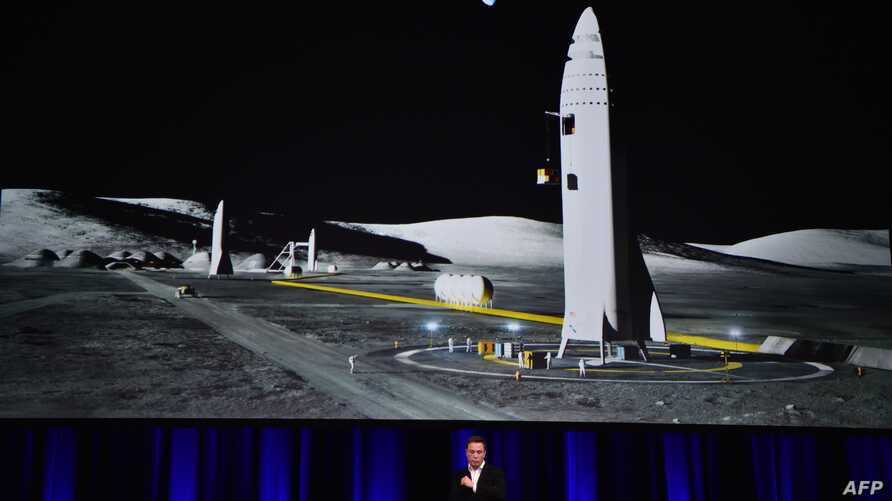 Billionaire entrepreneur and founder of SpaceX Elon Musk speaks below a computer generated illustration of his new rocket at the 68th International Astronautical Congress 2017 in Adelaide, Australia, Sept. 29, 2017.