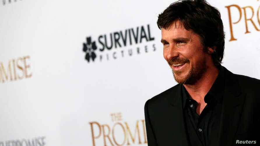 """Cast member Christian Bale poses at the premiere of """"The Promise"""" in Los Angeles, California, April 12, 2017."""
